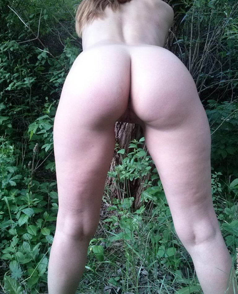 Naked girl in doggystyle position in the forest photo 01050