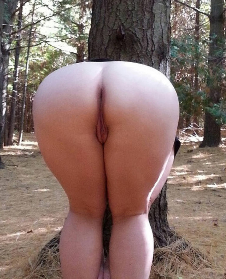 Naked girl in doggystyle position in the forest photo 02200