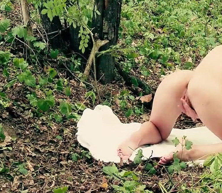 Naked girl in doggystyle position in the forest photo 04353