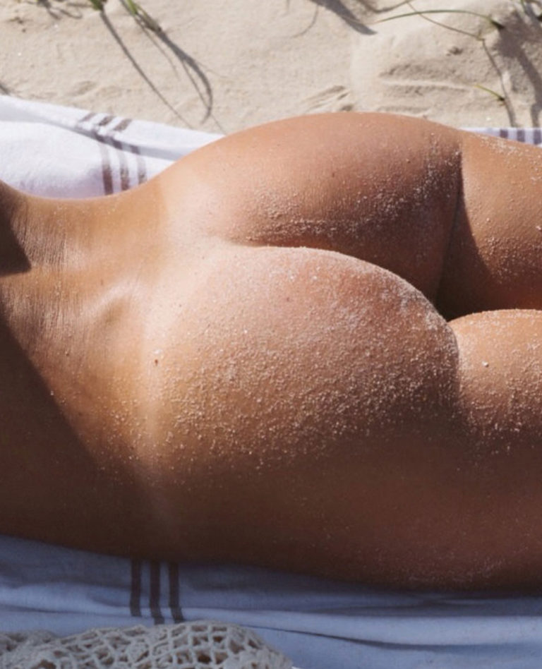 Naked sunbathing tanning on the beach pic 03827
