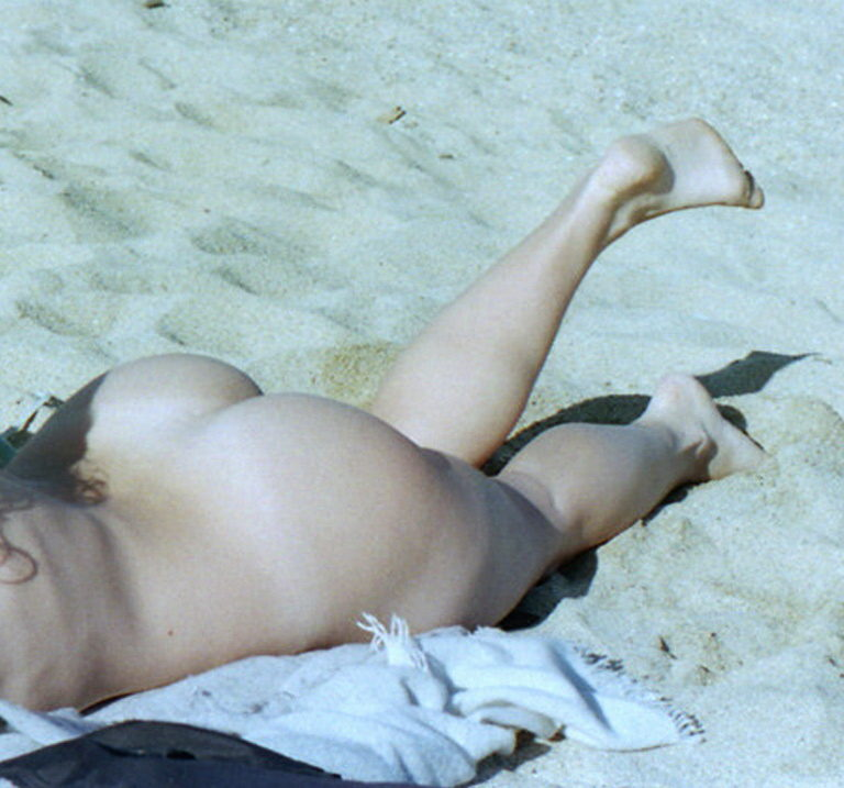 Naked sunbathing tanning on the beach pic 04048