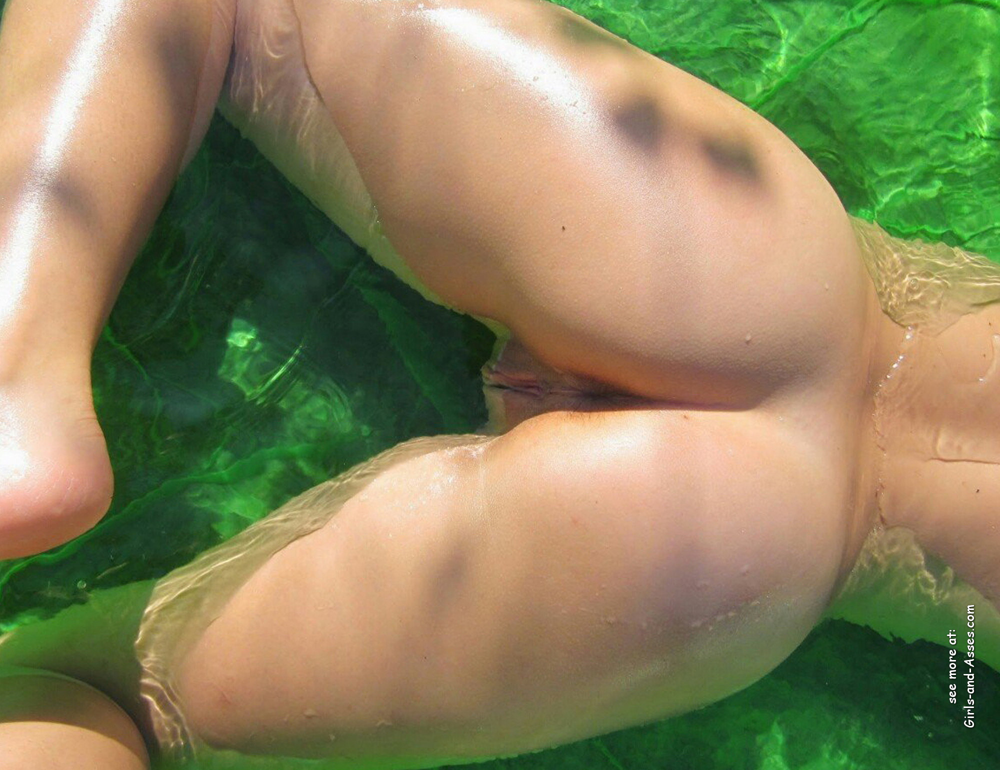 beautiful naked ass by the pool photo 01858
